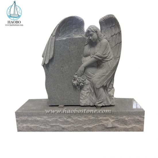 Winged Angel Holds Rose Carved Tombstone